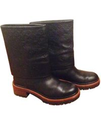 2cf243e35ce8 Lyst - Louis Vuitton Leather Boots in Black