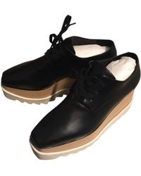 Stella McCartney Chaussures à lacets simili cuir noir