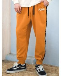 F.ILLUMINATE - [unisex] Black Taping Track Pants-yellow - Lyst