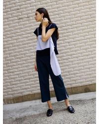 OUOR - Maison Trousers - Lyst