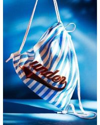 UNDER82 - Shinning Drawstring Wappen Bag Blue - Lyst
