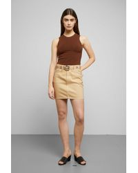 8a56366c1 New Look Yellow Asymmetric Leather-look Mini Skirt in Yellow - Lyst