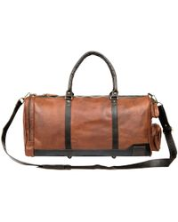 MAHI - Leather Columbus Holdall And Duffle Bag In Vintage Brown With Mahogany Details - Lyst