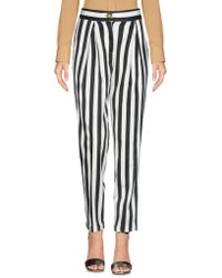 THINK BELIEVE - Casual Trouser - Lyst