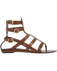 57a5acb0cc8 Lyst - Sartore Studded Flat Gladiator Sandals in Brown