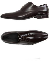 Versace - Zapatos de cordones - Lyst