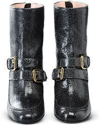 c260a23a94a Boutique Moschino - Buckled Leather Ankle Boots - Lyst