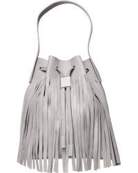 Gvyn - Yuri Coachella Fringed Bucket Bag In Cement - Lyst