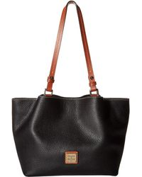 Dooney & Bourke - Pebble Small Flynn (black/tan Trim) Handbags - Lyst
