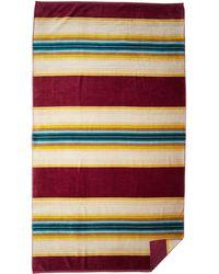 Pendleton - Oversized Serape Stripe Beach Towel (serape Magenta) Bath Towels - Lyst