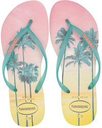 ab4f3301e06535 Lyst - Slydes Copacabana Palm Print Slider Flat Sandals in White
