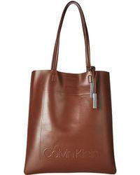 Calvin Klein - Nora Pressed Pebble Pvc North/south Tote (black Animal) Tote Handbags - Lyst