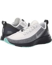5d4a975830493 Nike - Odyssey React Shield (summit White metallic Silver black) Women s  Running