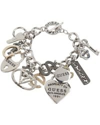 Guess - 179167-21 (ir/hematite/gold) Charms Bracelet - Lyst
