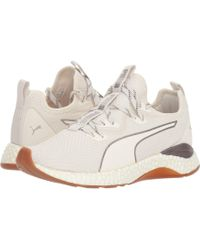 859b82c4411a PUMA - Hybrid Runner Luxe (whisper White  White) Women s Lace Up Casual  Shoes