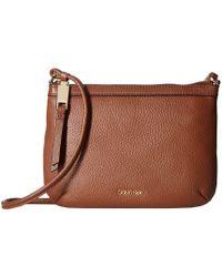 Calvin Klein - Carrie Pebble Key Item Crossbody (walnut) Cross Body Handbags - Lyst