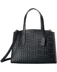 00540f5042 COACH - Signature Leather With Border Rivets Charlie Carryall (black brass)  Handbags -
