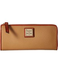 Dooney & Bourke - Pebble Zip Clutch - Lyst