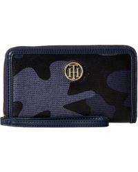Tommy Hilfiger - Th Serif Signature Carryall Coated Camo Wristlet (tommy Navy) Wristlet Handbags - Lyst
