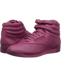 3ada99ec7b96ed Lyst - Reebok The Freestyle Hi Sneaker in Luxe Blue and Purple Shade ...