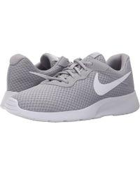 hot sale online a8045 2f22c Nike - Tanjun (blackblackwhite) Womens Running Shoes - Lyst