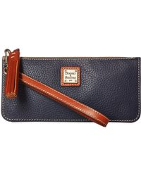 Dooney & Bourke - Pebble Tatum Wristlet (wine/tan Trim) Wristlet Handbags - Lyst
