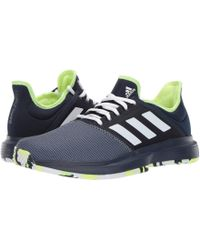 the latest dee32 4e13c adidas - Gamecourt Multicourt (collegiate Navy footwear White hi-res Yellow)
