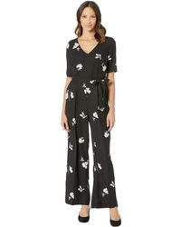 69570996a130 Vince Camuto - Elbow Sleeve Tossed Flowers V-neck Jumpsuit (rich Black)  Women s