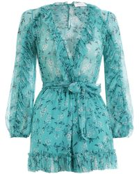 fe09bb9d99 Lyst - Zimmermann Paradiso Floating Playsuit in Black