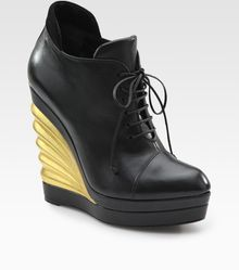 Saint Laurent Leather Lace-up Wedge Ankle Boots - Lyst
