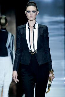 Gucci Spring 2012 Black And Gold Clutch - Lyst