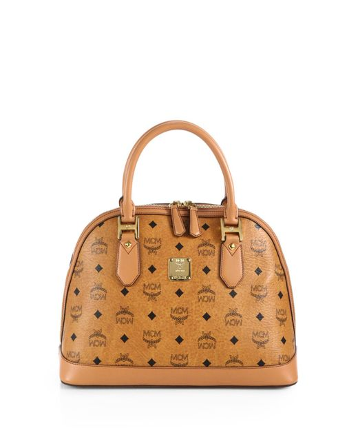 Mcm heritage medium coated canvas bowler bag in brown lyst for What does mcm the designer stand for