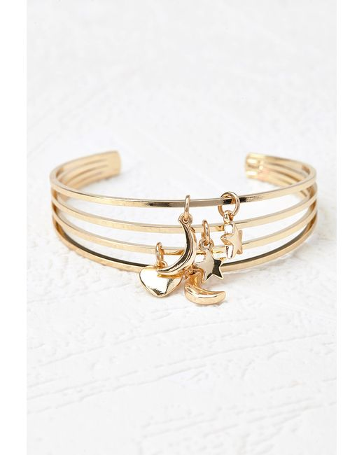 forever 21 cutout charm arm cuff in gold lyst