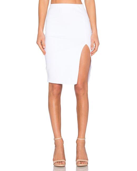 donna mizani side slit midi skirt in transparent lyst