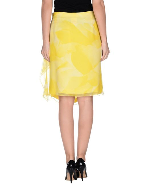rena lange knee length skirt in yellow lyst