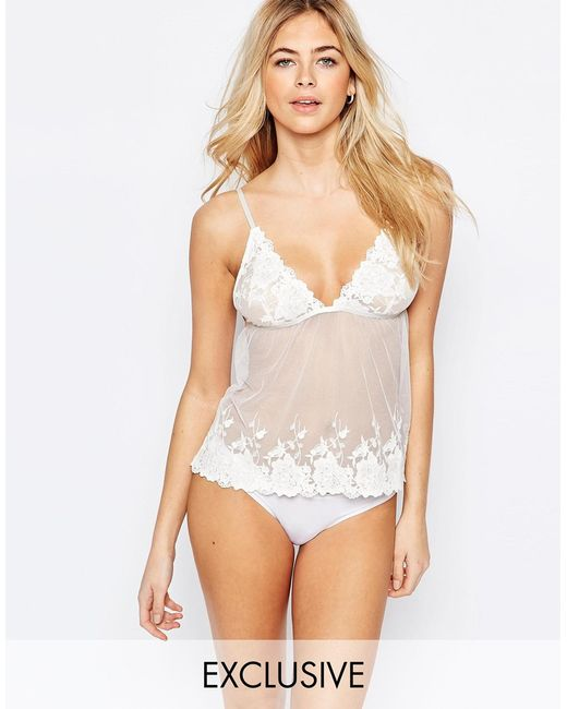Browse the range of cami tops with tie-sleeves, stylish collars and open back styles to match your outfit today. your browser is not supported. Missguided lace cami bralette in white. $ Miss Selfridge 90's shirred strappy top. $ Lipsy satin cami top in ivory. $ Lipsy satin cami top in black. $ Vila Lace Trim Cami Top.