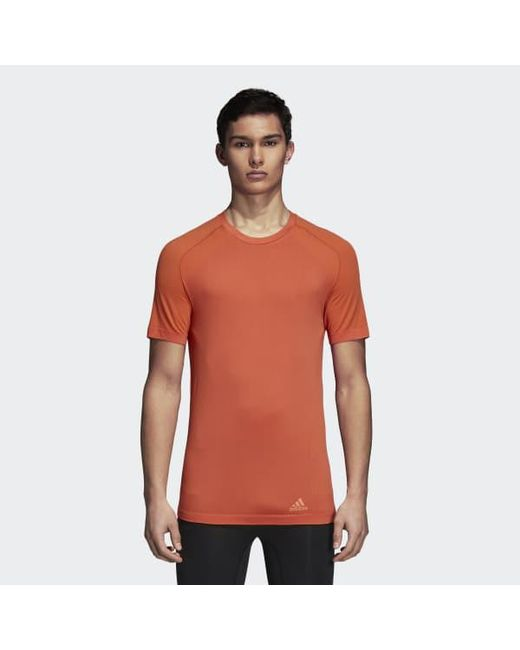 377d5188c5 Adidas - Orange Ultra Primeknit Light Tee for Men - Lyst ...