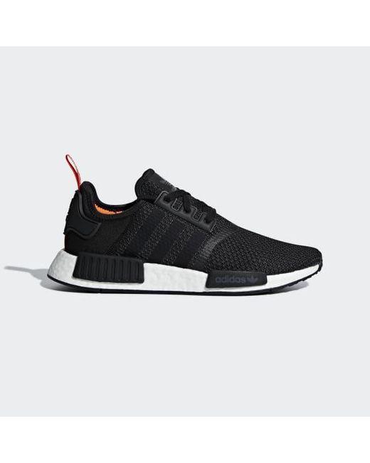 lyst adidas nmd r1 scarpe in nero per gli uomini.