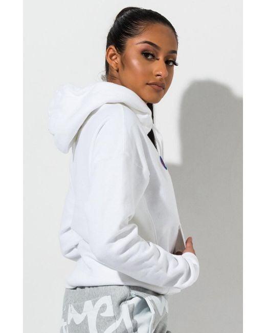 33559e23440 Champion Women's Script Logo Reverse Weave Hoodie in White - Save 22 ...