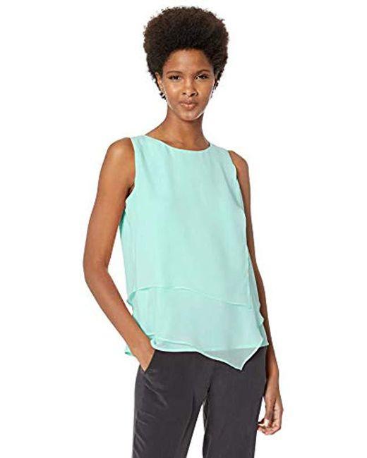 Calvin Klein - Blue Sleeveless Top With Asymmetrical Hem - Lyst
