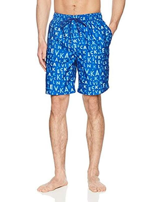5b0d0329f08fa Lyst - Calvin Klein Ck Monogram Printed Swim Trunk in Blue for Men ...