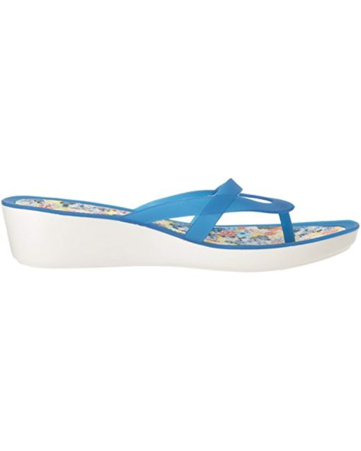 91518f4286ac Lyst - Crocs™ Isabella Print Wedge Flip Flop in Blue - Save 33%