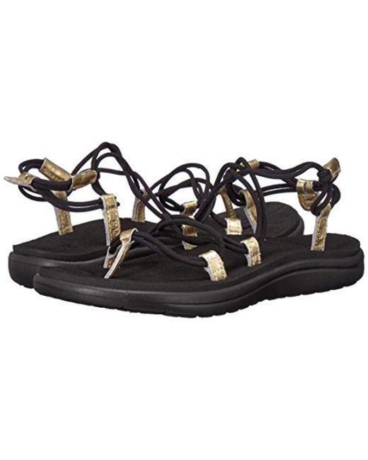 eecce8df9775 Lyst - Teva W Voya Infinity Metallic Sandal in Black - Save 18%
