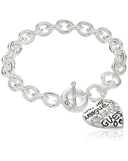 "Guess - Metallic ""basic Graffiti Logo Heart Toggle Charm Bracelet - Lyst"