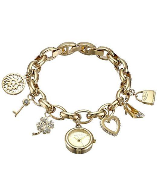 Anne Klein - Metallic 10-7604chrm Swarovski Crystal Gold-tone Charm Bracelet Watch - Lyst