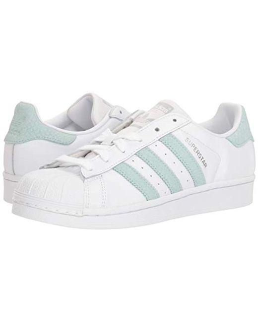 adidas Originals adidas Originals Women's Superstar Sneaker, WhiteAsh GreenSilver Metallic, 10 from Amazon | Real Simple