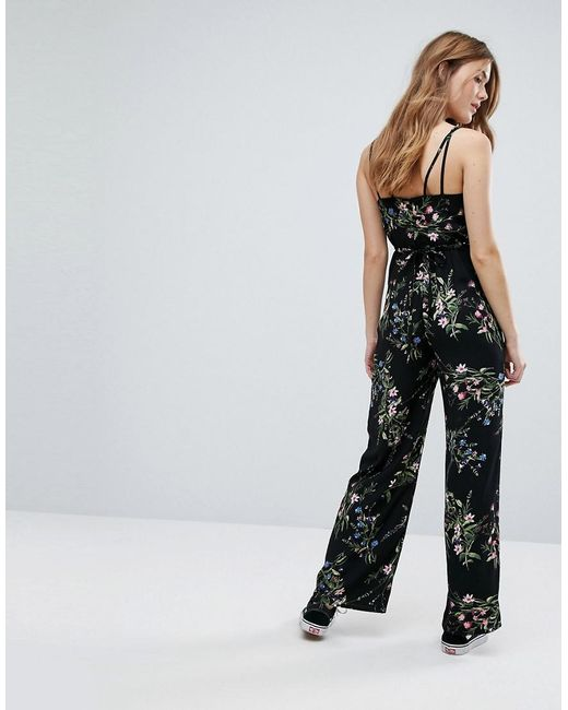 56b973fd57f ... New Look - Black Floral Strappy Jumpsuit - Lyst