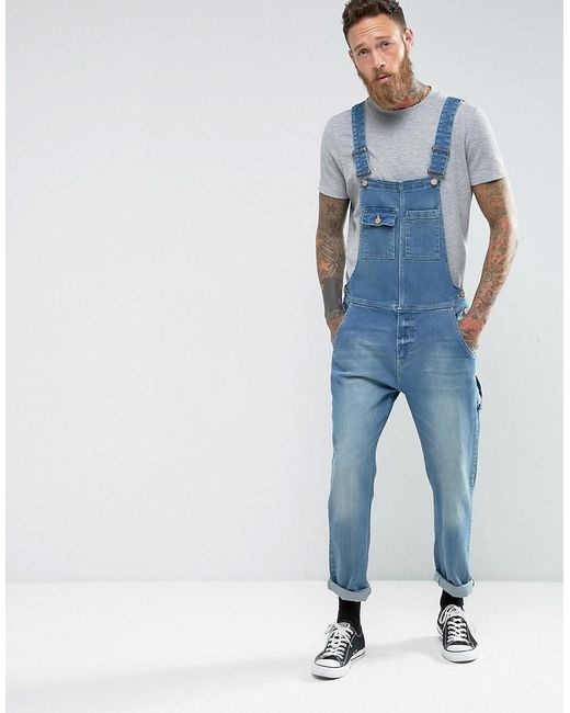 asos denim dungarees in vintage mid wash blue with work wear styling in blue for men lyst. Black Bedroom Furniture Sets. Home Design Ideas
