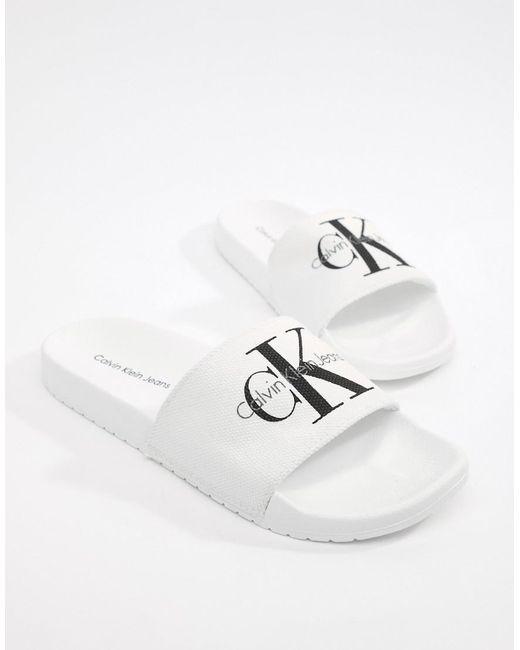68d1a03fd474 Calvin Klein Viggo Logo Sliders in White for Men - Save 37% - Lyst