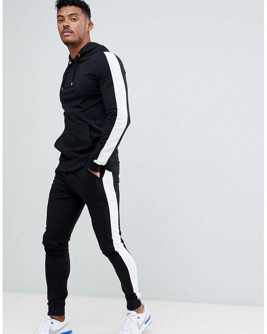Chándal negro con sudadera con capucha ajustada y joggers muy ajustados con rayas laterales en blanco ASOS de hombre de color Black